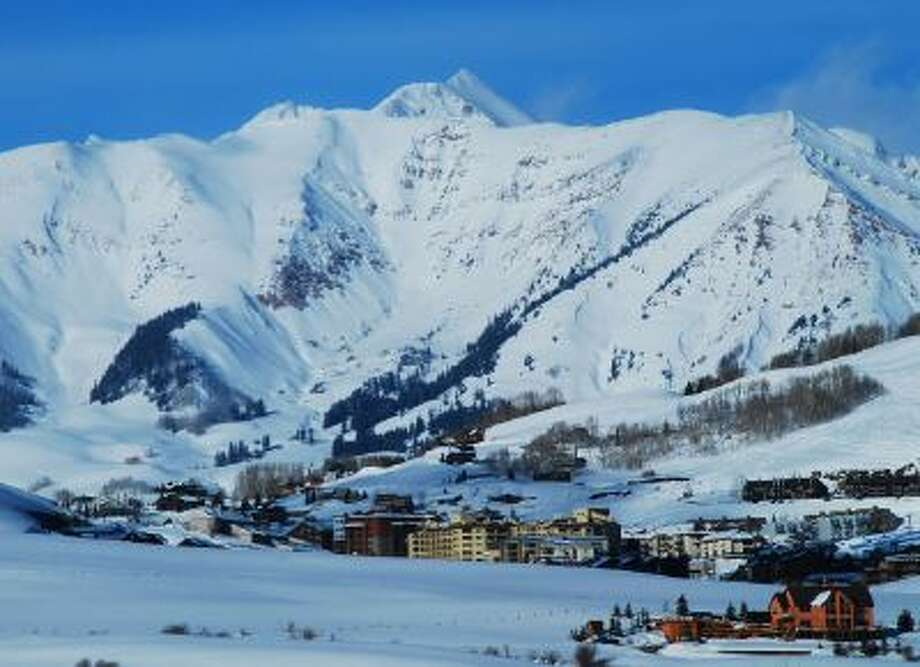 Crested Butte Mountain Resort's base area is dwarfed by the Elk Mountains. Crested Butte, Colo., is nestled among the snowiest peaks in Colorado. For residents and visitors, it's all about the snow.