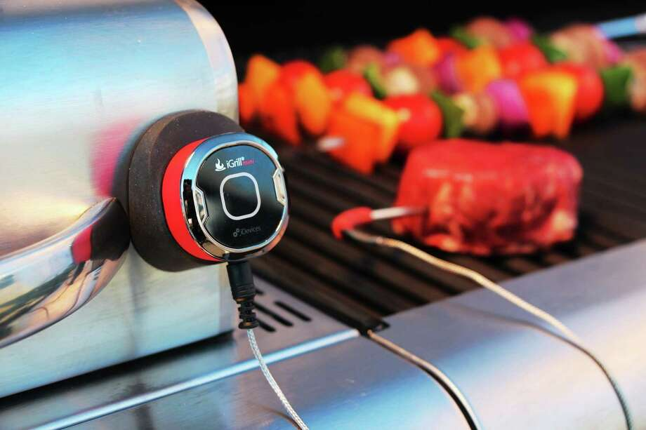 With probe inserted into meat, a cable leads to a magnetic base, which transmits internal temperature via Bluetooth to an iPhone or iPad. Photo: IDevices LLC