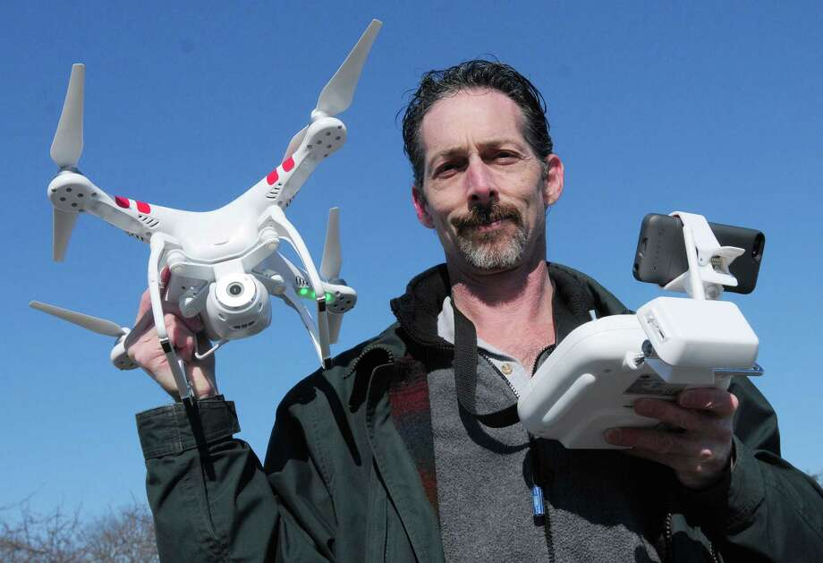 Peter Sachs of Branford, a Branford fire police captain, shows off his DJI Phantom 2 Vision, commonly known as a drone. Photo: Peter Hvizdak — New Haven Register      / ©Peter Hvizdak /  New Haven Register
