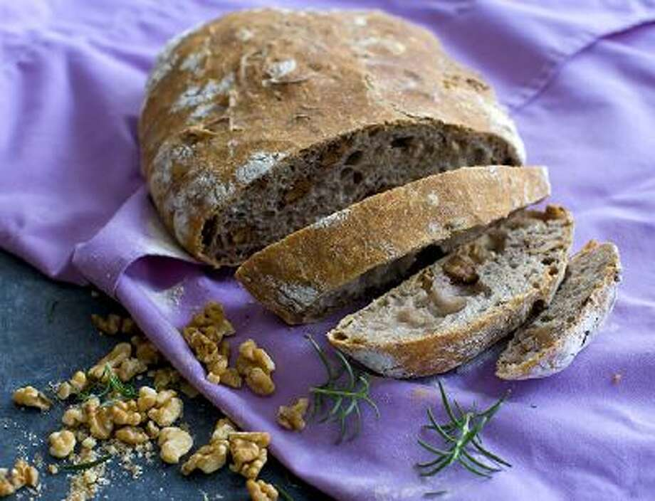 This Feb. 3, 2013 photo shows a loaf of no knead walnut rosemary bread in Concord, NH. Photo: AP / FR170582 AP