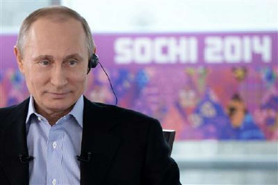 Russian President Vladimir Putin listens to a translation during an interview to Russian and foreign media in the Russian Black Sea resort of Sochi, Russia. For President Vladimir Putin, the Winter Olympics he brought to Sochi have always been about far more than sports. Photo: AP / RIA Novosti Kremlin