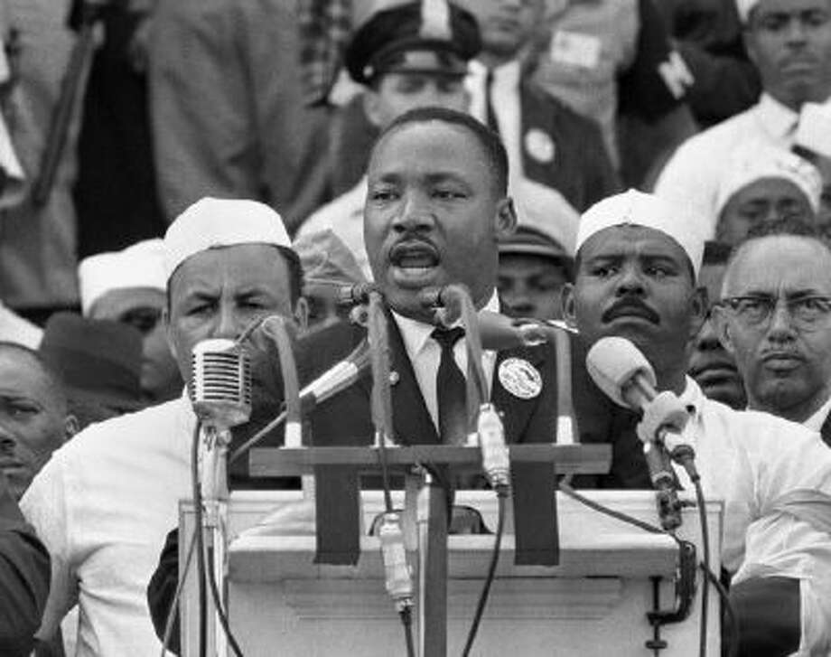 """In this Aug. 28, 1963, black-and-white photo Dr. Martin Luther King Jr., head of the Southern Christian Leadership Conference, addresses marchers during his """"I Have a Dream"""" speech at the Lincoln Memorial in Washington."""