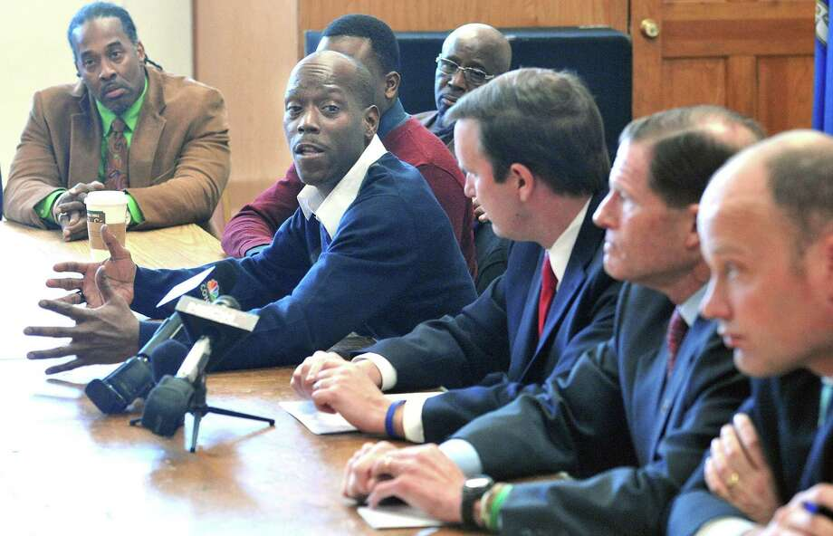 Doug Bethea, who lost his son to gun violence in 2006, speaks during a roundtable discussion with the community at the Elks Lodge in New Haven. Seated next to him, from left, are U.S. Sens. Chris Murphy and Richard Blumenthal and New Haven Superintendent of Schools Garth Harries. Photo: Peter Casolino — New Haven Register