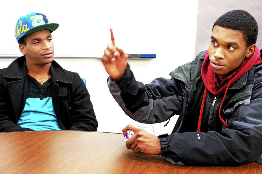 Marquell Wright looks on as Josh Williams makes a point at a recent youth roundtable to discuss issues in the community. Photo: VM Williams — New Haven Register