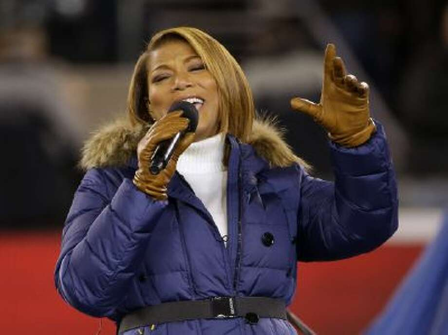 """Queen Latifah sings """"America the Beautiful"""" before the NFL Super Bowl XLVIII football game between the Seattle Seahawks and the Denver Broncos Sunday, Feb. 2, 2014, in East Rutherford, N.J."""