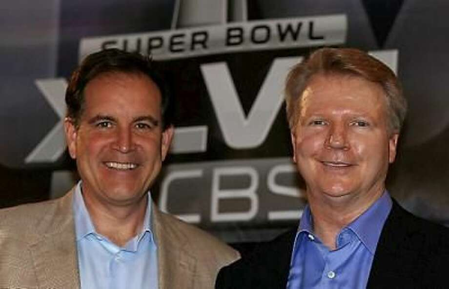 CBS Sports announcers Jim Nantz, left, and Phil Simms pose on stage at a Super Bowl XLVII Broadcasters Press Conference at the New Orleans Convention Center on January 29, 2013 in New Orleans, Louisiana. Photo: Getty Images / 2013 Getty Images
