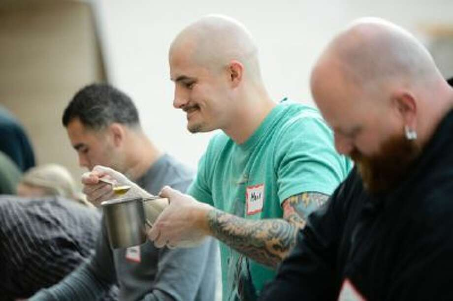 Mark Pike, 32, of Fredericksburg, Va., tastes his dish for the second annual Meal-Ready-To-Eat/MRE cook-off on Saturday at the National Museum of the Marine Corps in Triangle, Va.