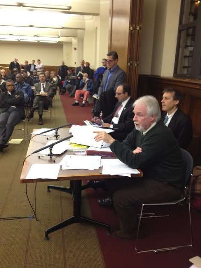 BZA staff listen to testimony at Tuesday night's meeting. Mary O'Leary/New Haven Register. Photo: Journal Register Co.