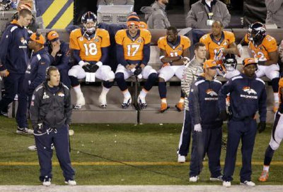 Peyton Manning sits on the bench during the second half of the Super Bowl.