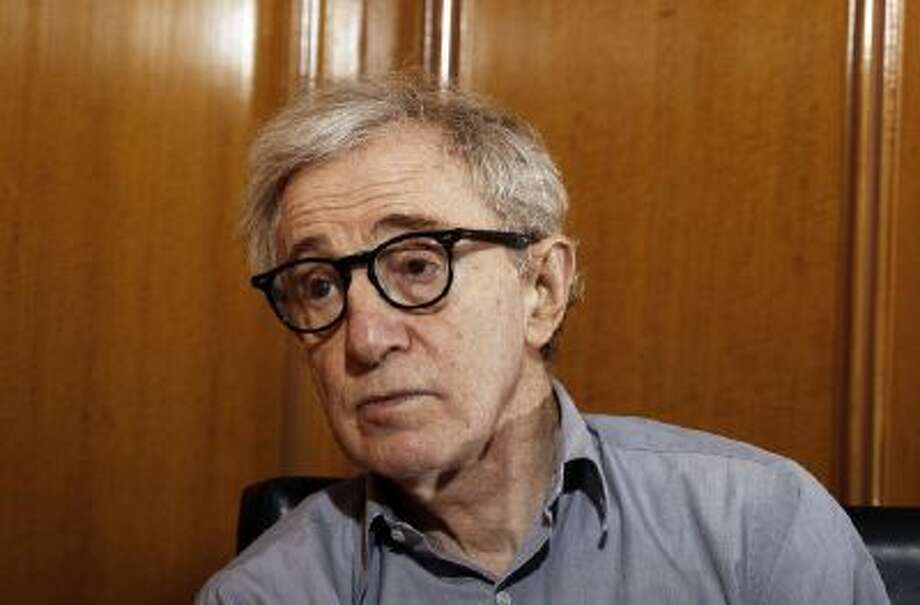 """In this Dec. 29, 2011 file photo, Woody Allen, director of the film, """"Midnight in Paris,"""" is photographed during an interview in Beverly Hills, Calif."""