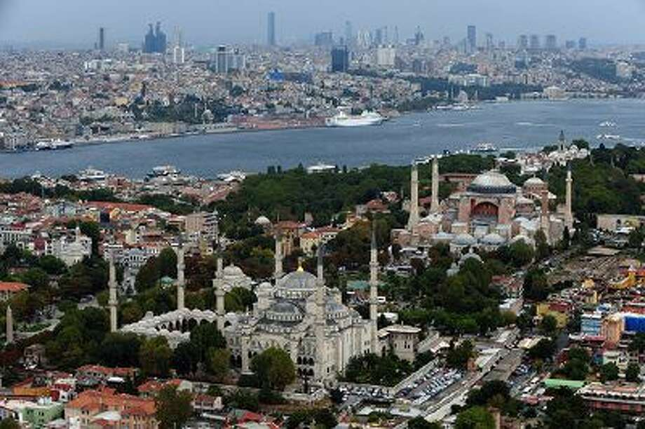 This Sept. 30, 2011 file photo shows Sultan Ahmed Mosque, better known as the Blue Mosque, left, and Hagia Sophia in the historic Sultanahmet district in Istanbul, Turkey. Photo: AP / AP2013