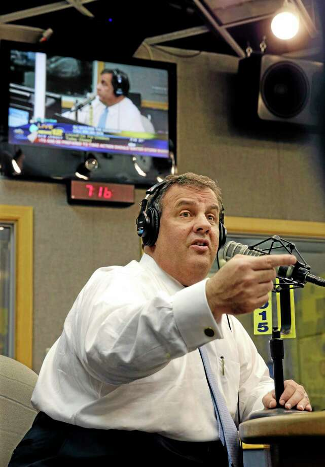 """New Jersey Gov. Chris Christie sits in a studio during his radio program, """"Ask the Governor""""  broadcast on NJ 101.5, Monday, Feb. 3, 2014, in Ewing, N.J. During the program, Christie took questions from callers for the first time in more than three weeks as his campaign looked for a way to pay for lawyers as a political payback scandal continues. (AP Photo/Mel Evans, Pool) Photo: AP / Pool, AP"""