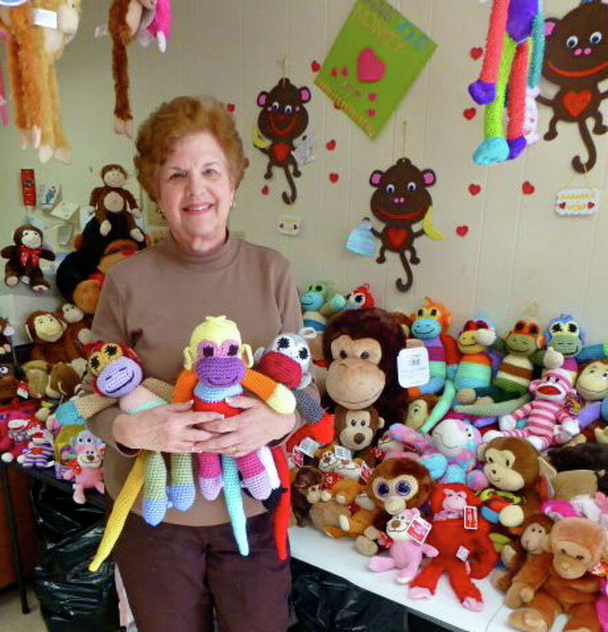 Seymour resident Barbara Tchakirides holds some of the monkeys she crocheted for the eighth annual Monkey Love Drive to benefit needy children. Patricia Villers/Register Photo: Journal Register Co.