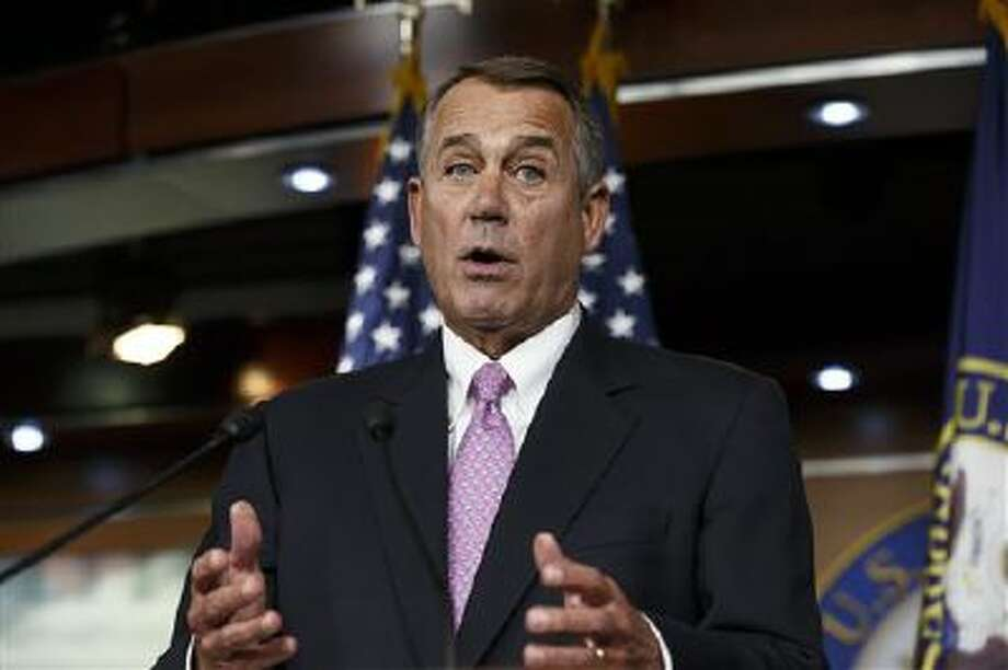 House Speaker John Boehner speaks Thursday during a news conference. He said it will be difficult to pass immigration legislation this year, dimming prospects for one of President Barack Obama's top domestic priorities. Photo: AP / AP