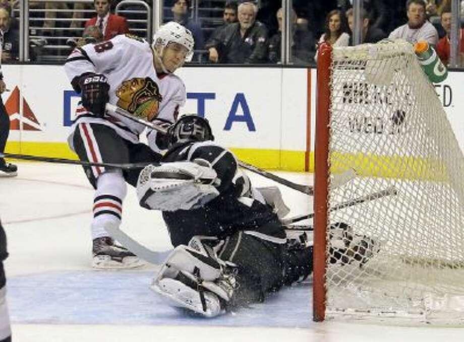 Patrick Kane scores on Kings goalie Jonathan Quick in the Blackhawks' 5-3 win.