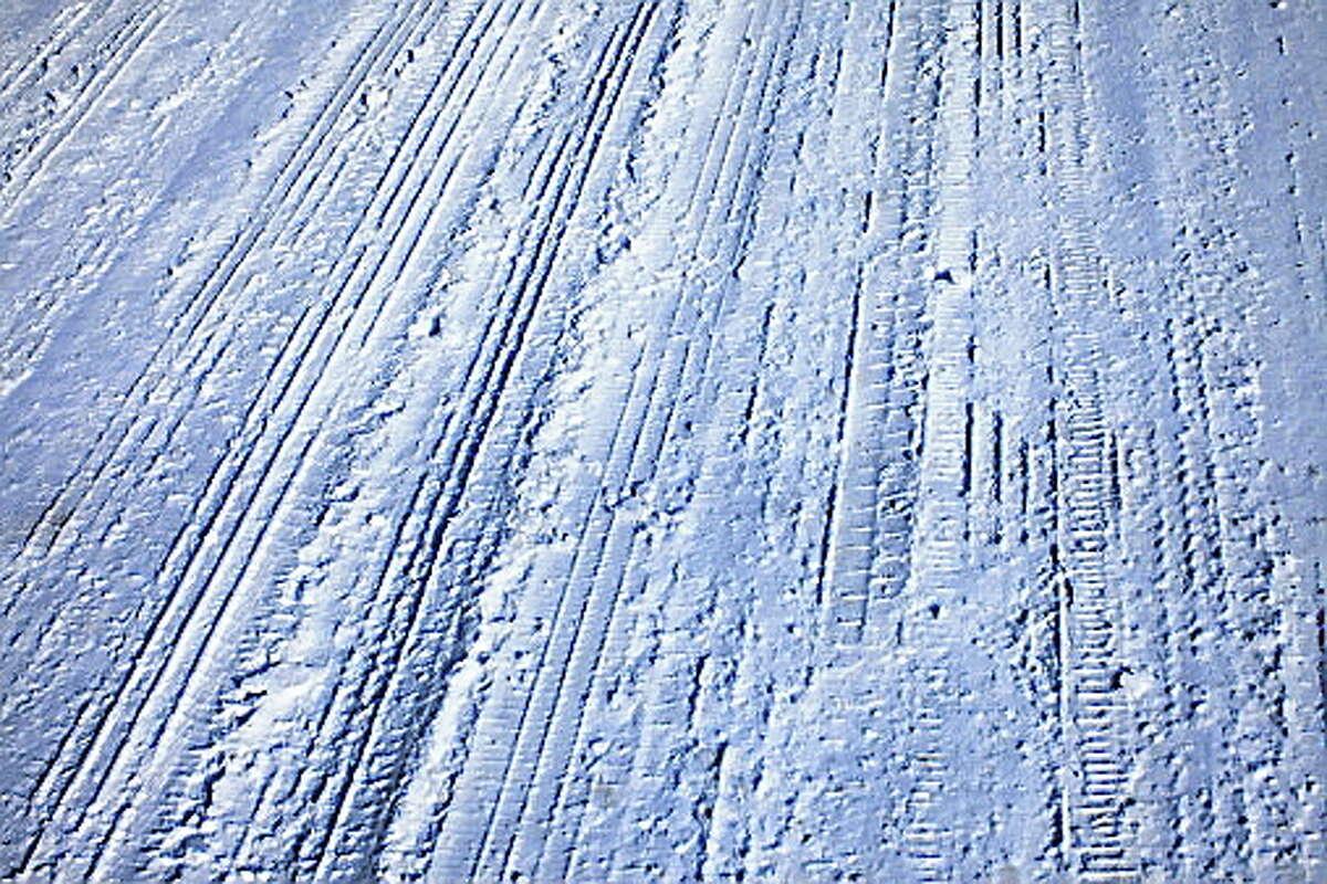 Winter Tire Tracks on Street