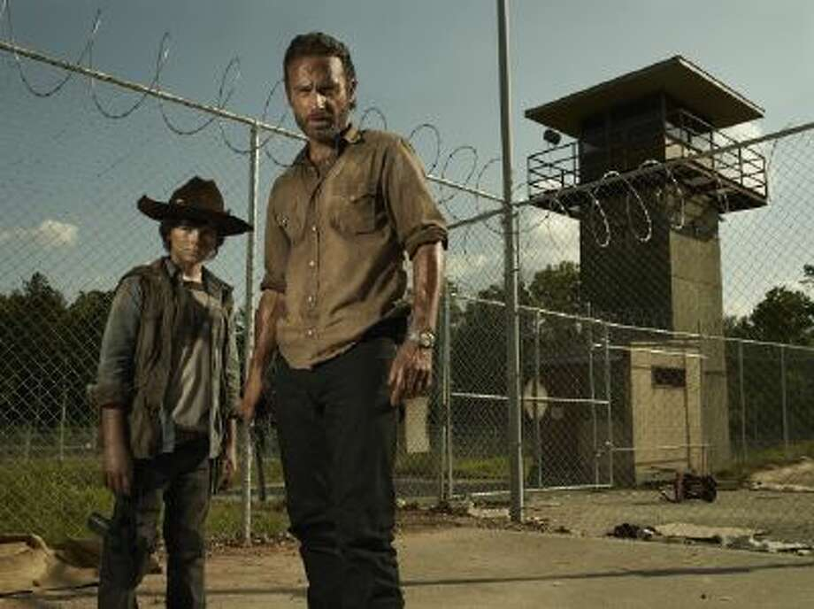 "Carl Grimes (Chandler Riggs) and Rick Grimes (Andrew Lincoln) in ""The Walking Dead."""