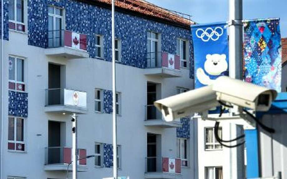Security cameras are seen along the Canadian section of the athlete's village at the Sochi Winter Olympics, Tuesday, Feb. 4, 2014, in Sochi, Russia.