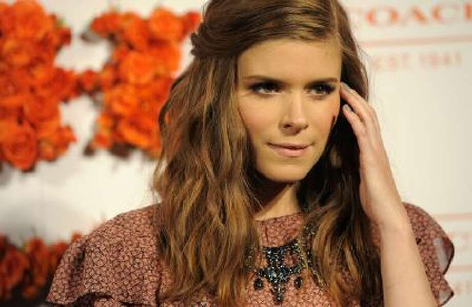 Actress Kate Mara poses at the 3rd Annual Coach Evening to Benefit Children's Defense Fun at Bad Robot on Wednesday, April 10, 2013 in Santa Monica, Calif.