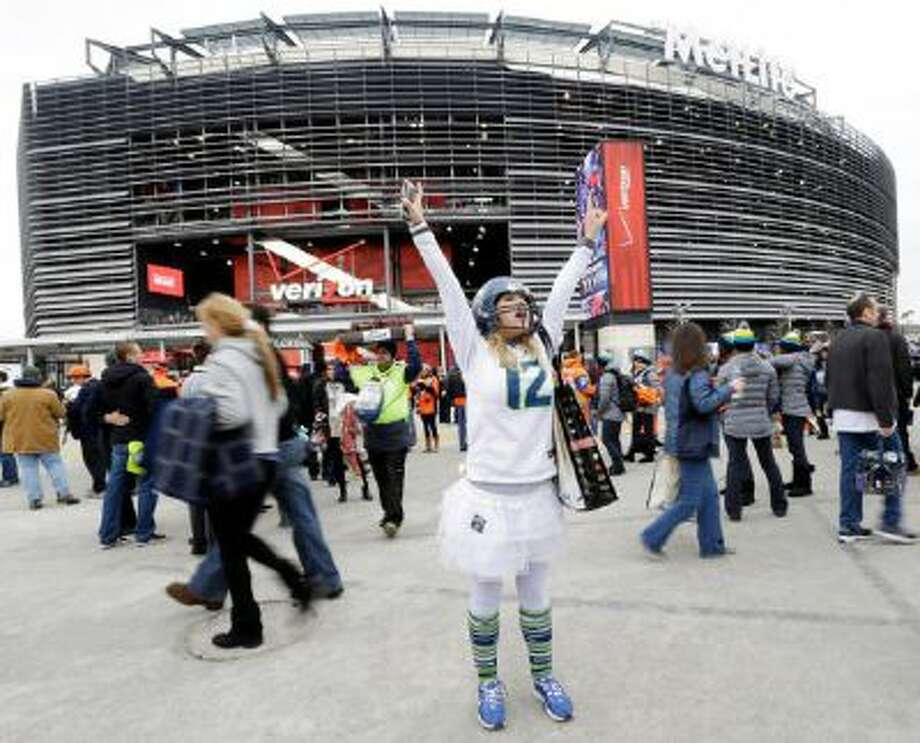 Lacey Surprenat of Seattle cheers outside MetLife Stadium before the NFL Super Bowl XLVIII football game Sunday in East Rutherford, N.J.