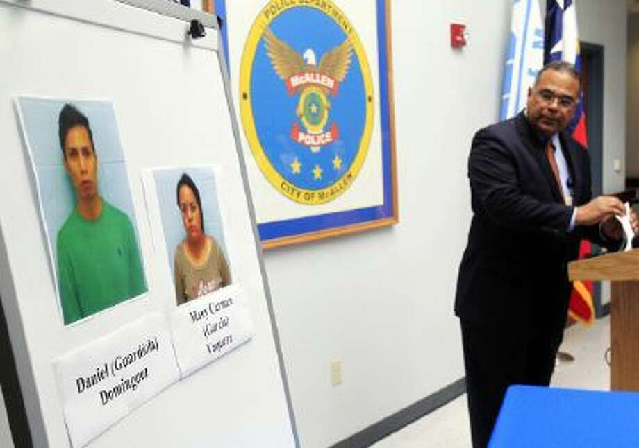McAllen Police Chief Victor Rodriguez displays photos of Daniel Guardiola Dominiguez, left, and Mary Carmen Garcia, who were arrested Sunday after arriving at the border with 96 fraudulent credit cards that were produced using data stolen during the Target security breach late last year, Monday, Jan. 20, 2014, in McAllen, Texas.