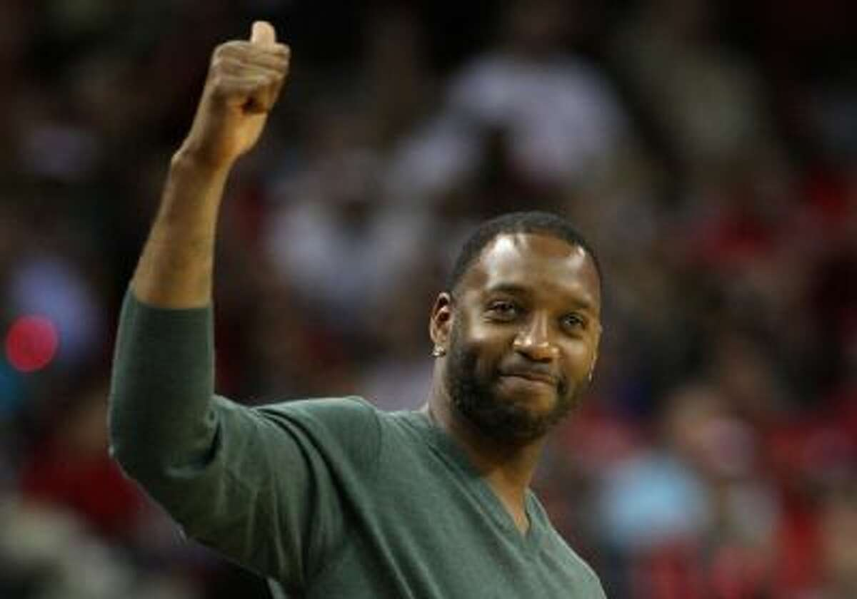 In this file photo, former Houston Rocket Tracy McGrady acknowledges the crowd during a game between the Charlotte Bobcats and Houston Rockets at Toyota Center on October 30, 2013 in Houston, Texas. NOTE TO USER: User expressly acknowledges and agrees that, by downloading and or using this photograph, User is consenting to the terms and conditions of the Getty Images License Agreement.