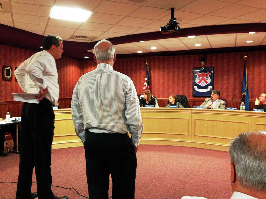 Superintendent Scott Schoonmaker, left, and Personnel/Business Director Don Winnicki address the North Branford Town Council Tuesday night. Photo: Joe Amarante — New Haven Register
