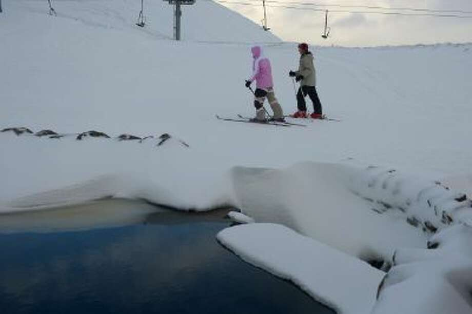 Skiers and snowboarders enjoy the recent snowfall at Glenshee ski center on February 8, 2013 in Glenshee, Scotland.