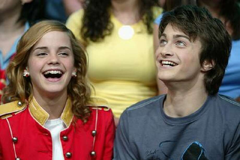 Actors Emma Watson and Daniel Radcliffe appear on stage during MTV's Total Request Live at the MTV Times Square Studios May 21, 2004 in New York City. Photo: Getty Images / 2004 Getty Images