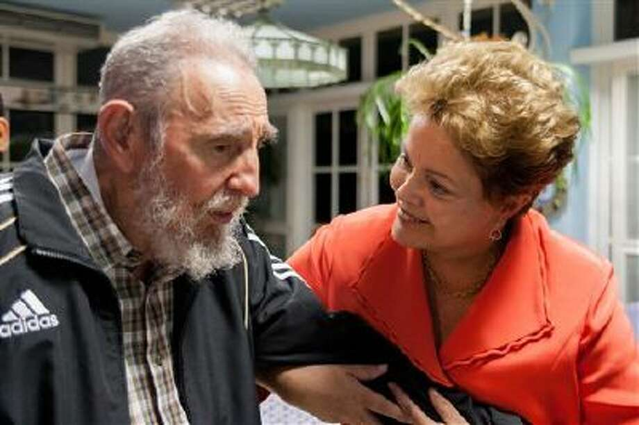 Brazil's President Dilma Rousseff visits Monday with Cuba's former President Fidel Castro in Havana, Cuba. Rousseff is in Havana to attend the Community of Latin American and Caribbean States summit. Photo: ASSOCIATED PRESS / AP2014