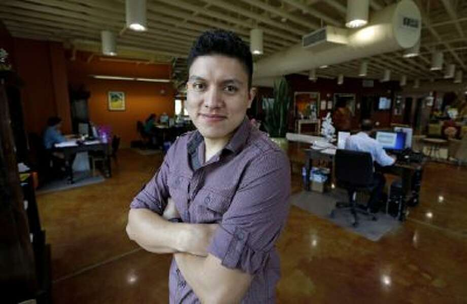 Manuel Enrique Angel, 28, of El Salvador, poses in Houston. He estimates it will take him up to eight months to save the money for the citizenship application.