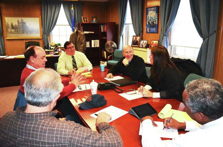 PHOTO CAPTION ó Mayor Edward M. OíBrien, back center, outlines his 2014 Legislative Agenda, or wish list, with members of the cityís state delegation Feb. 3 at City Hall. From left, state Rep. Louis P. Esposito Jr., D-West Haven, state Rep. Stephen D. Dargan, D-West Haven, state Rep. Paul Davis, D-Orange, state Sen. Gayle Slossberg, D-Milford, and mayoral Executive Assistant John W. Lewis. (Contributed Photo/Michael P. Walsh) Photo: Journal Register Co.