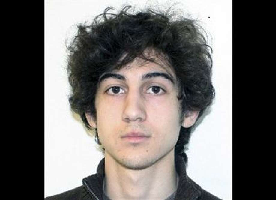 Boston Marathon bombing suspect Dzhokhar Tsarnaev is charged with using a weapon of mass destruction in the bombings on April 15, 2013, near the finish line of the Boston Marathon. Last Thursday, U.S. Attorney General Eric Holder authorized the government to seek the death penalty in the case against Tsarnaev. Photo: ASSOCIATED PRESS / A2013