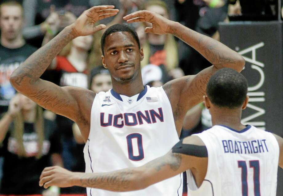UConn forward Phillip Nolan (0) reacts after picking up his fourth foul in the second half against Cincinnati. Guard Ryan Boatright is at right. Cincinnati won 63-58. Photo: Al Behrman — The Associated Press   / AP