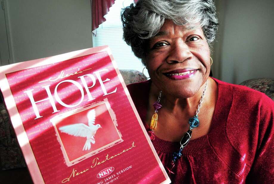 (Arnold Gold ó New Haven Register)  Mae Gibson Brown is photographed in her home in New Haven on 1/30/2014 with a copy of the New Testament which she includes in her Shoe Box Ministry gift packages. Photo: Journal Register Co.