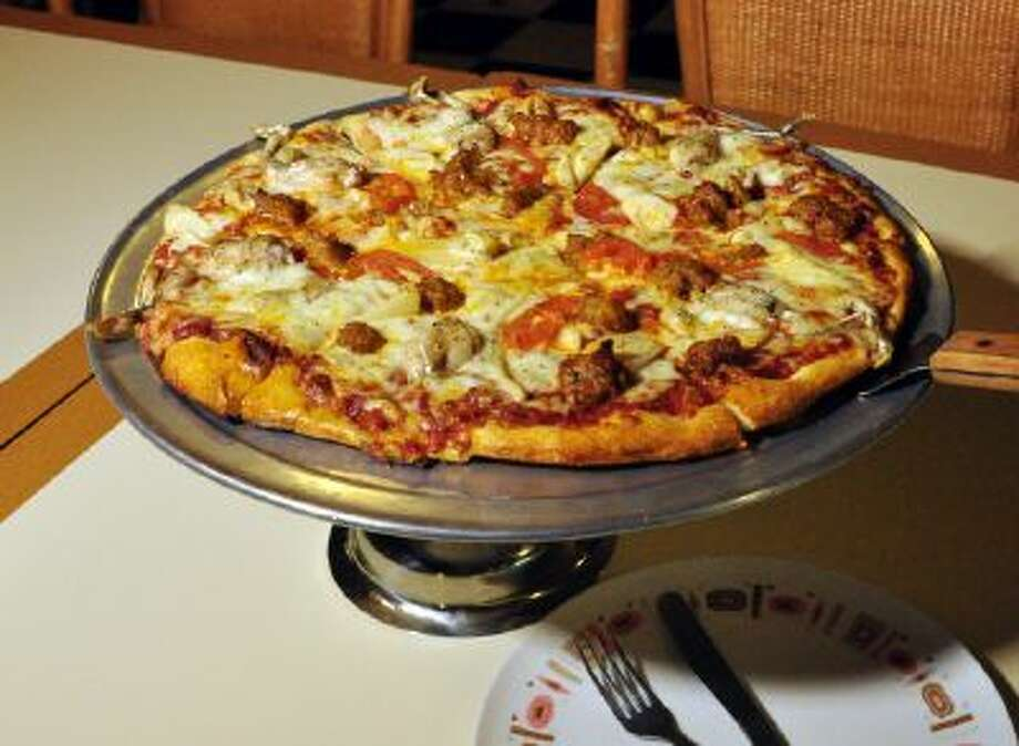"""""""Everglades Pizza"""" is seen on January 28, 2014 at Neighborhood Pizza in the Gulf Coast city of Fort Myers, Fla. The pie has python meat, alligator sausage and frogs legs."""