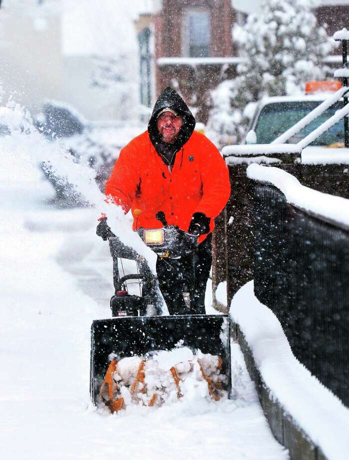 Bill W. (would not give last name) clears snow along Chapel Street in New Haven during Monday's snowstorm. He works for J&A Lead Abatement out of East Haven. 2/3/2014.  pcasolino@NewHavenRegister Photo: (Peter Casolino - New Haven Register)