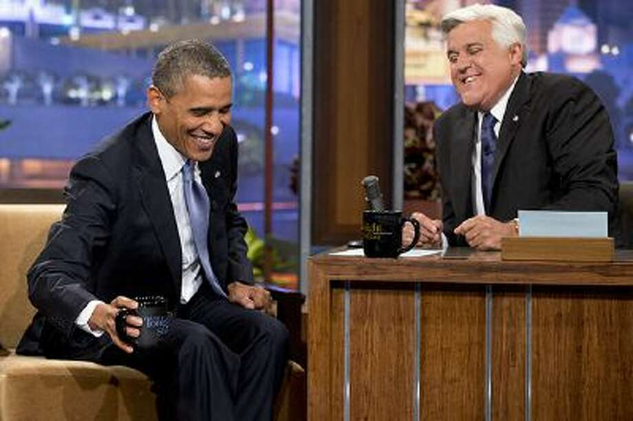 """President Barack Obama, left, smiles as he talks with Jay Leno during a commercial break during the taping of his appearance on """"The Tonight Show with Jay Leno"""" in Los Angeles, Tuesday, Aug. 6, 2013. Photo: AP / AP2013"""