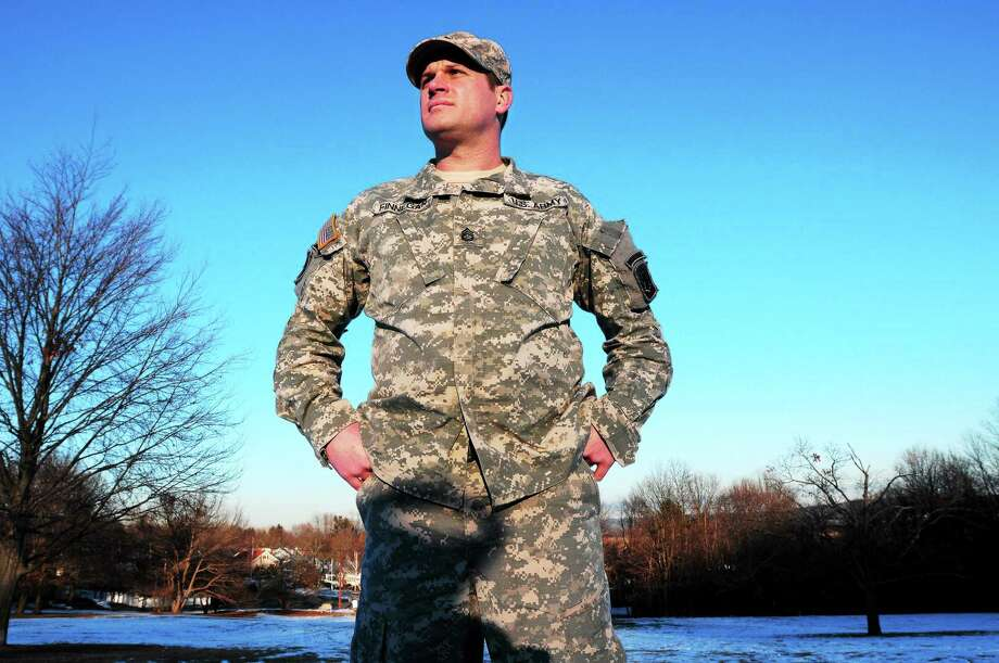 (Arnold Gold / New Haven Register)  Sgt. First Class Michael Finnegan of the U.S. Army 102nd Infantry is photographed at East Rock Park in New Haven. Photo: Journal Register Co.