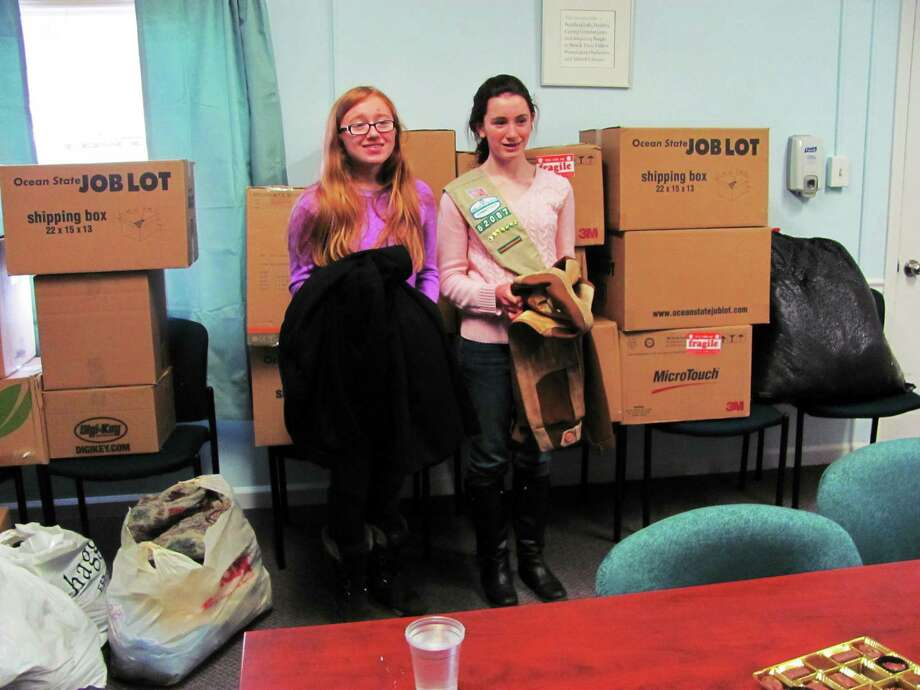 Left, Ashlinn Virgulto, 13, Roisin Beirne, 13, with half of the clothes they collected anf domated to the Eddy Shelter in Middletown. Photo: Journal Register Co.