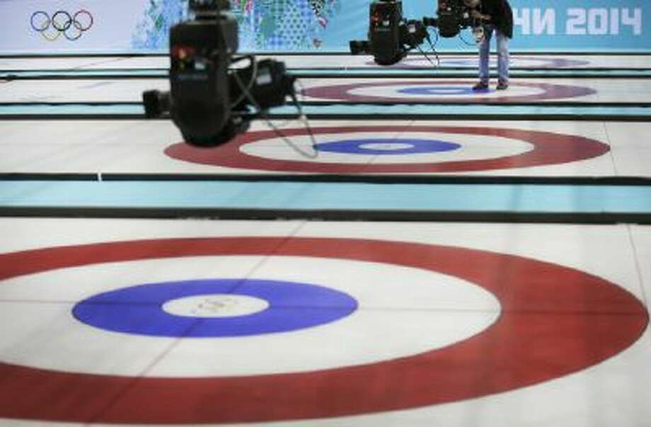 A technician checks broadcast cameras at the Ice Cube Curling Center during final preparations ahead of the 2014 Winter Olympics, Tuesday, Feb. 4, 2014, in Sochi, Russia.