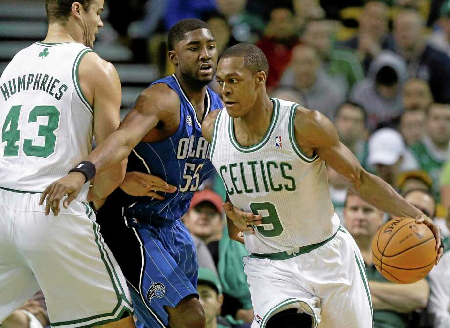 Celtics guard Rajon Rondo (9) looks for an opening around Magic guard E'Twaun Moore (55) in the fourth quarter Sunday. Photo: Steven Senne — The Associated Press   / AP