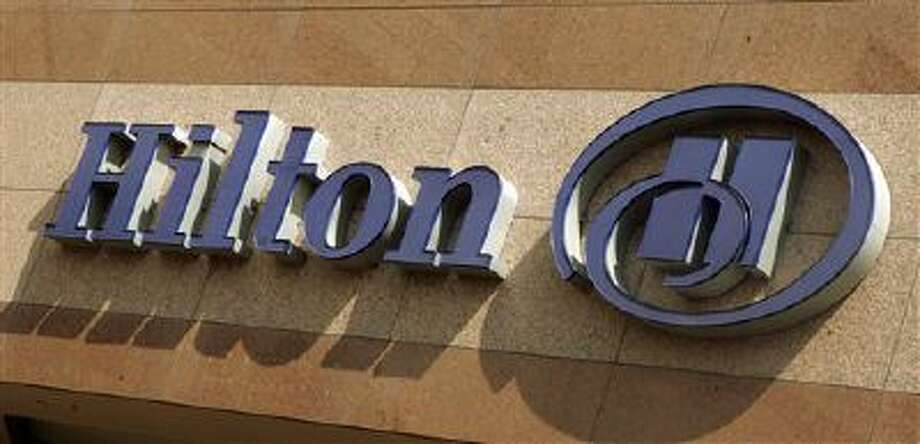 The Hilton corporate logo appears on the Hilton Hotel in Long Beach, Calif. Photo: ASSOCIATED PRESS / AP2007