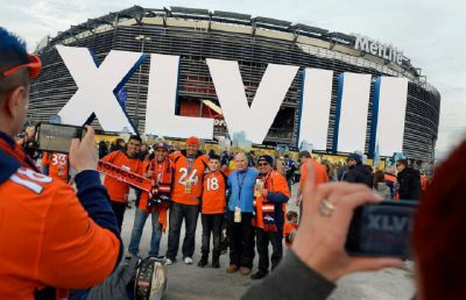 Arturo Vargas (right side of the group) and his family and friends all from Aurora, Colorado have their photo taken outside of the stadium prior to the game.