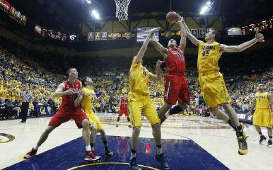 California forward David Kravish (45) blocks a shot attempt by Arizona guard Nick Johnson (13) during the first half Saturday in Berkeley, Calif.