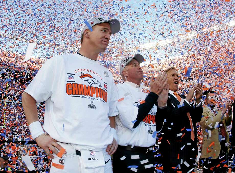 The Register's Dan Nowak believes Peyton Manning will add a second Super Bowl title to his resumé Sunday against the Seahawks. Photo: Charlie Riedel — The Associated Press   / AP