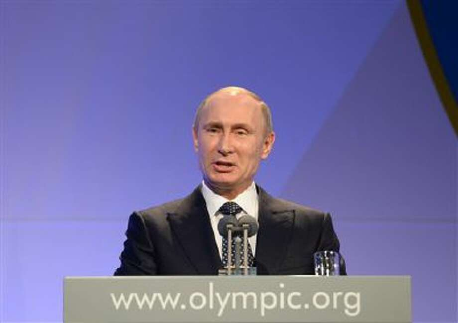 Russian President Vladimir Putin delivers his speech at the IOC President's Gala Dinner on the eve of the opening ceremony of the 2014 Winter Olympics in Sochi, Russia. Photo: AP / Pool AFP