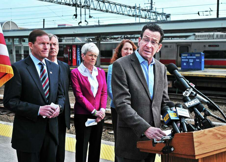 (Peter Casolino ó New Haven Register)   Governor Dannel P. Malloy speaks during a press conference announcing a $10 Million project upgrading the Metro North power supply. Behind him, left to right are; Senator Richard Blumenthal, Department of Transportation Commissioner James Redeker, LT. Governor Nancy Wyman and Congresswoman Elizabeth Esty. The press conference was held at Union Station in New Haven.  pcasolino@NewHavenRegister Photo: Journal Register Co.