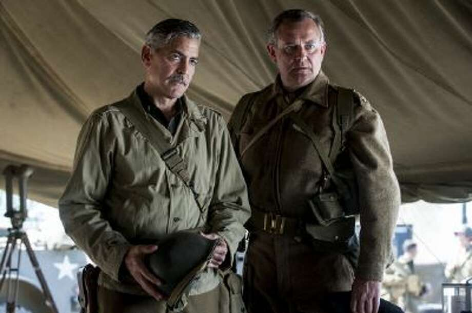 "This image released by Columbia Pictures shows George Clooney, left, and Hugh Bonneville in ""The Monuments Men."""