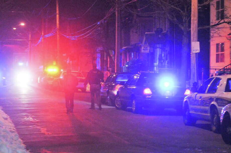 Police investigate a homicide on Kossuth Street in New Haven. Photo: Peter Casolino — New Haven Register